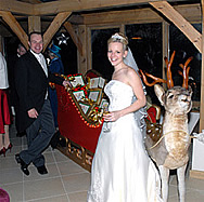 Giles and Amelia with Reindeerat their Christmas Wedding at Gaynes Park, Epping, Essex