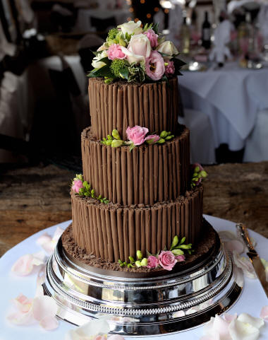 Chocolate Wedding Cake decorated with fresh floral decoration by Essex Florist